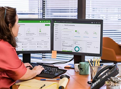 A human resources manager works with her company's HRIS software