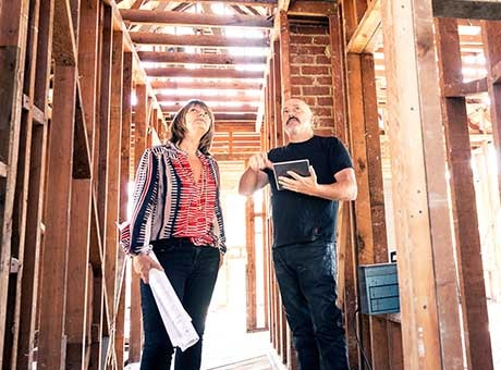 A home inspector inspects a home under construction