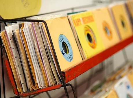 Shelves full of music records played at a business