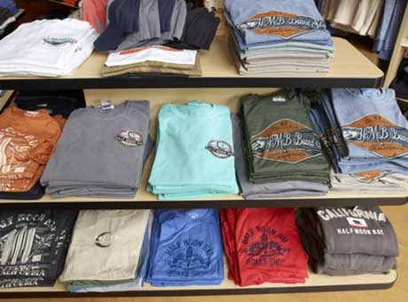 Shirts for sale on shelves at a small business retailer