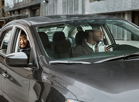 An Uber driver transports passengers