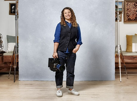 Video producer poses with her camera
