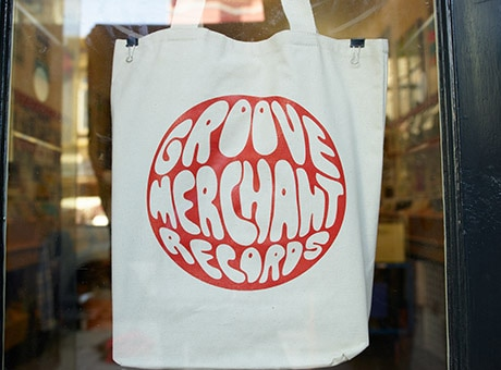 A Bag With a Record Shop's Logo That Was Created for Free by the Business