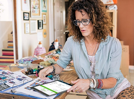 A Small Business Owner Calculates Her Minimum Monthly Profit