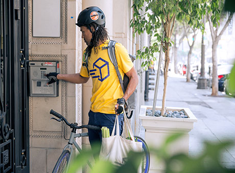 Delivery service courier stopping at a customer's apartment to drop off a package