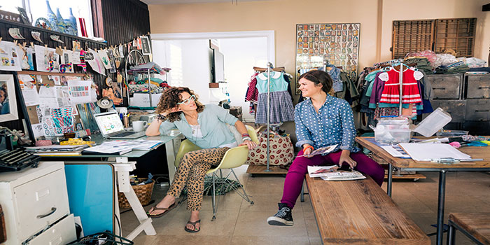 Two female small business owners discuss how to start an online store