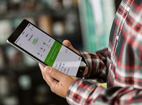 Man using apps to make it easier to manage payroll