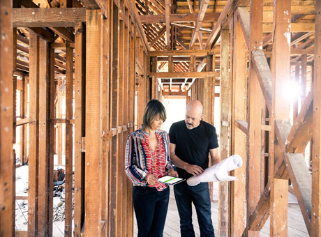 Small business owners evaluate performance metrics on job site