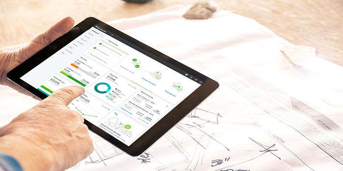 Small business employee uses cloud accounting software on tablet