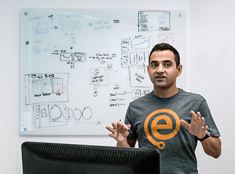 Engineer pitching the benefits of the freemium model to his company