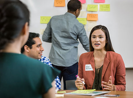 Small business employees brainstorm ways to reduce workplace stress