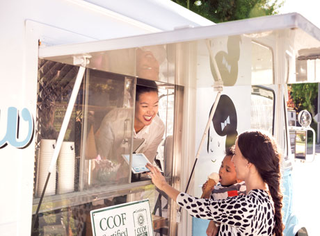 Food truck small business owner uses cryptocurrency while processing a point of sale