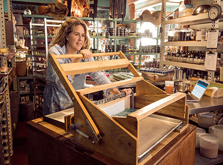 Retail store owner takes responsibility while crafting products to promote the small business brand