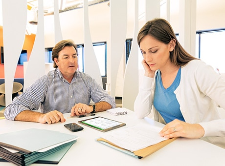 Client reviews an office expense checklist with her accountant