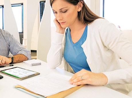 Hiring manager reviews the resume of a potential employee