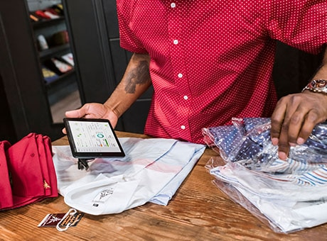 Worker packages products as part of the supply chain