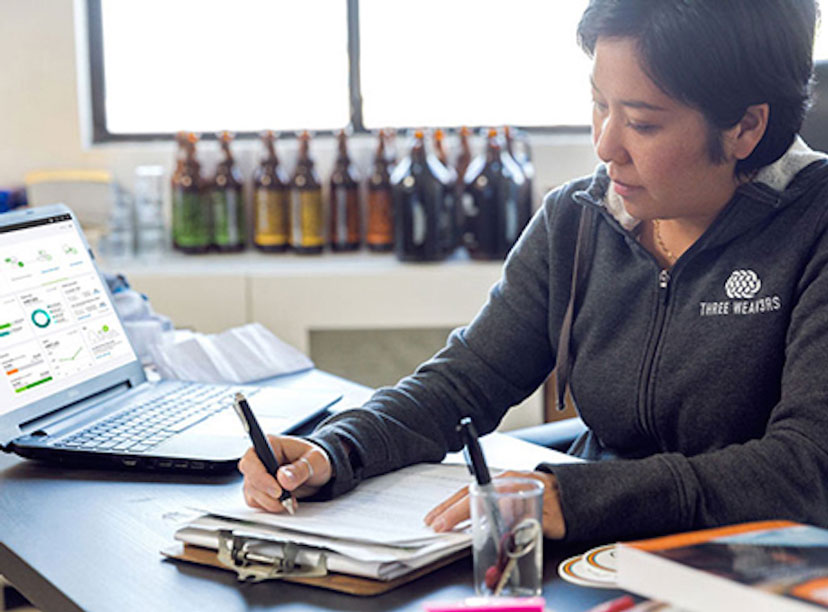 Accountant reviews a value chain analysis report of her company's manufacturing process