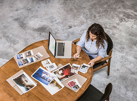 Small business owner reviews photos for test marketing