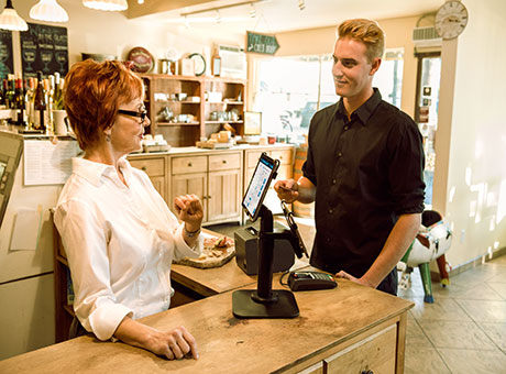 Man tipping a cashier for her service