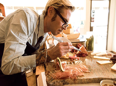 Man who wants to be a chef examining food
