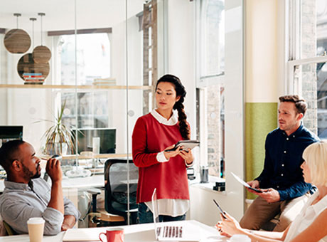 Small business owner leads a team meeting