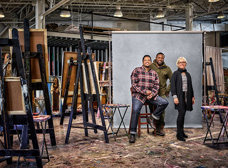 Small business owners discuss the importance of workplace equality while posing for a photo