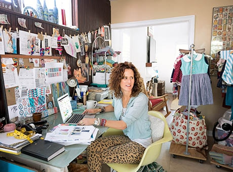 An interior designer works on her engaging company blog at her desk