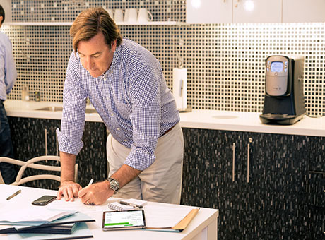 Small business owner developing a fire safety plan for his business