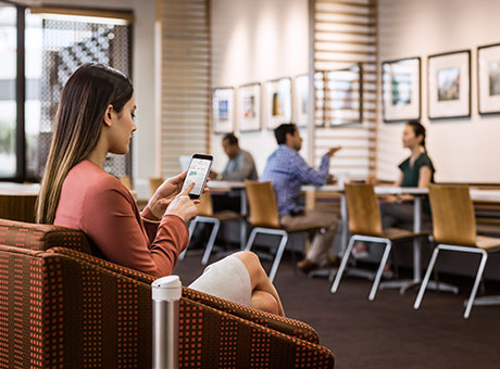 Woman uses the Wi-Fi at a local cafe