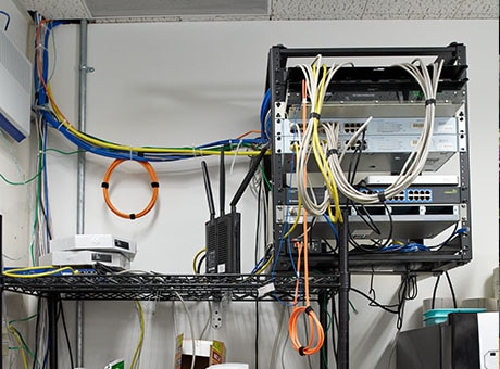 Business storeroom with poor cable management organization