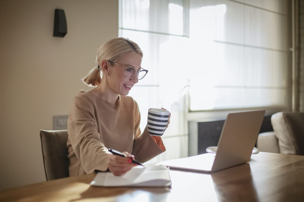 Woman looking at business proposal on laptop