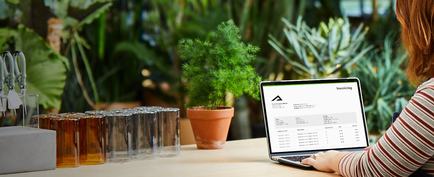 woman downloading invoice templates to send to clients