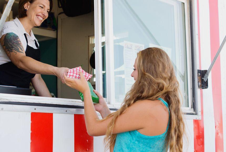 Stocksy_Happy food truck customer.jpg