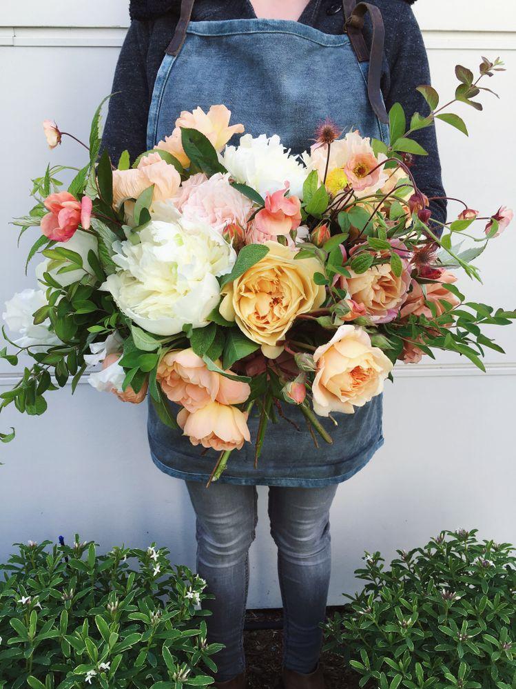 A bridal bouquet including blooms Rachel grew herself. (@finchandthistle)