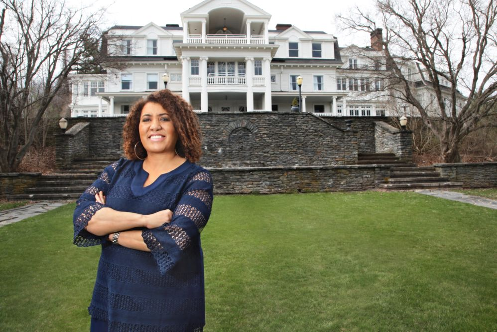 CEO Monique Greenwood on the grounds of Akwaaba's Mansion at Noble Lane