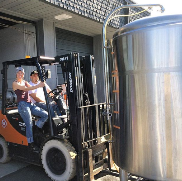 Moving a cold brew tank at the brewing facility