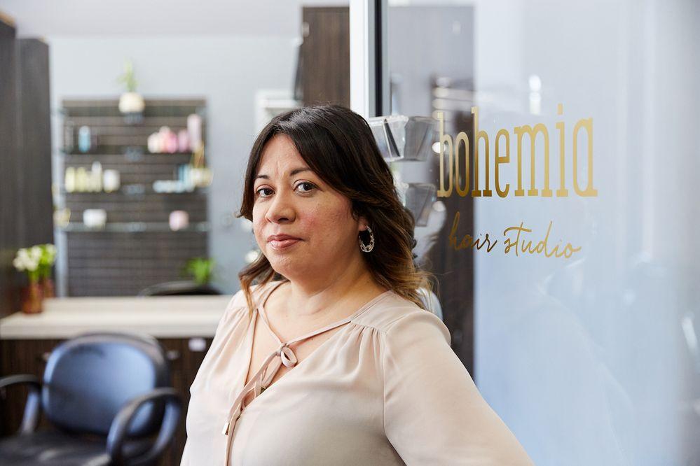 Hairstylist Brenda Maldonado welcomes clients at Bohemia Hair Studio