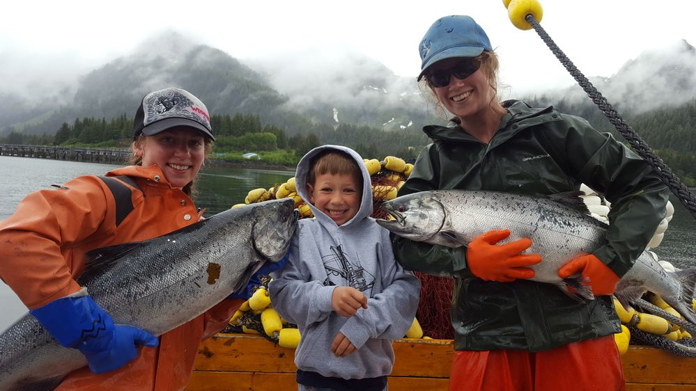 Two of Megan's crewmembers and her son, Fischer, aboard the F/V Centurion