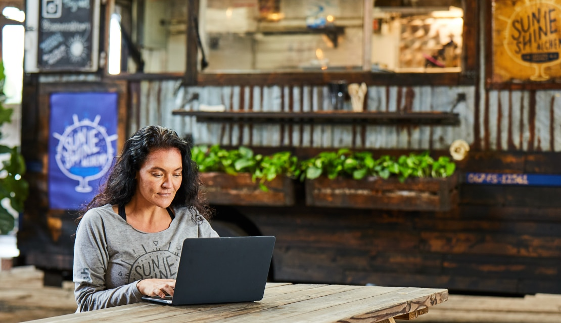 Woman in a cafe working on laptop
