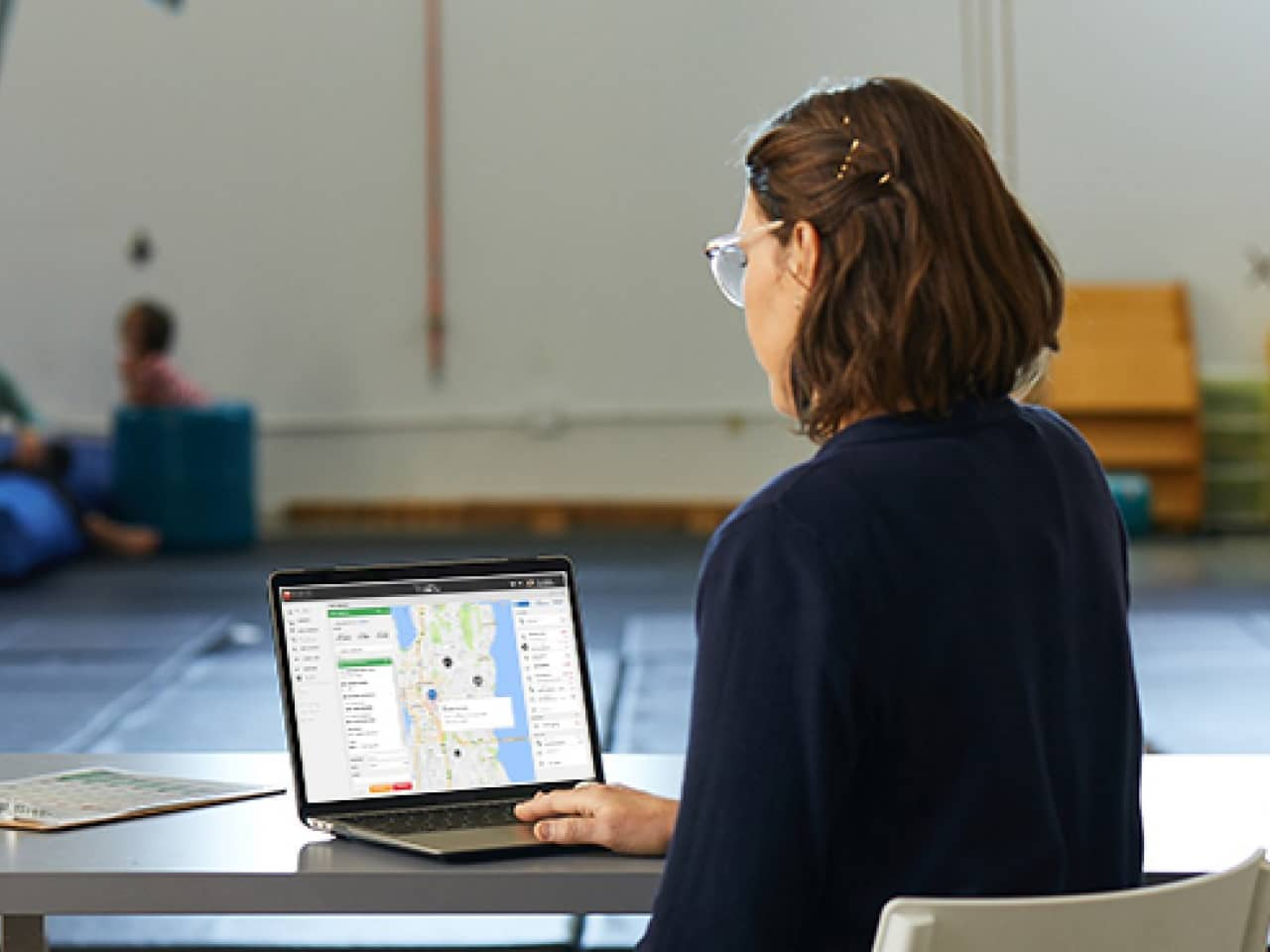 Woman using a laptop to track on a map