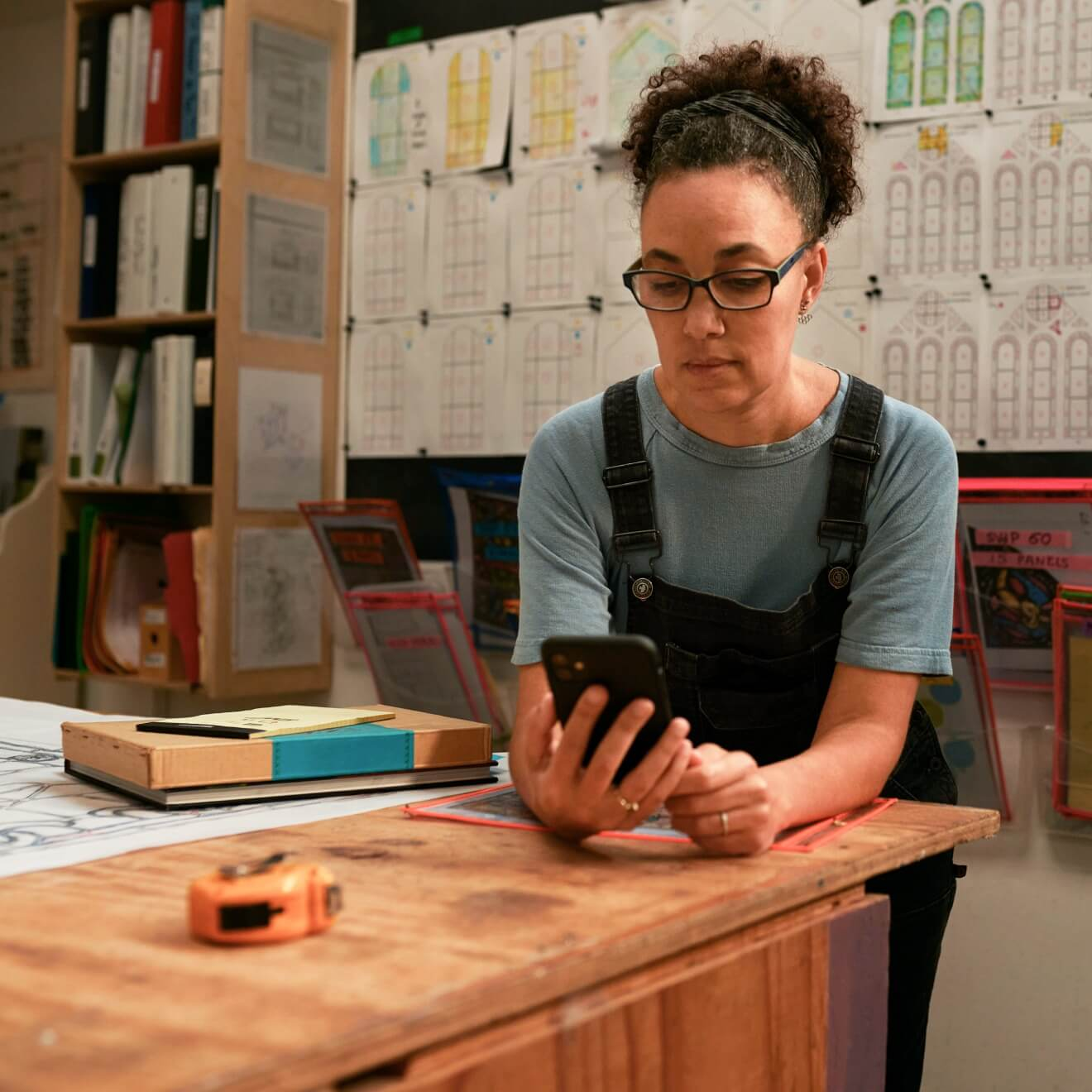 woman with phone nzilani glass conservation brand photo