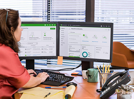 Woman using software to automate invoices
