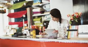 Female business owner using Quickbooks to calculate break even point of her business.