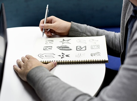 Designer works on sketches for a small business logo
