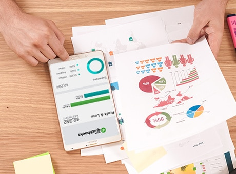 Entrepreneur looks at market data to determine if there is a market for her product
