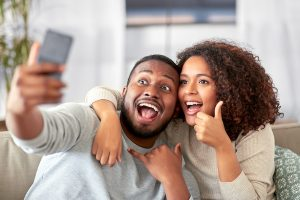 Couple taking selfies for social media in South Africa.