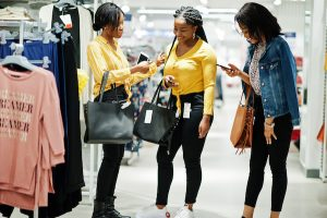 South African shopping in store while comparing prices online.