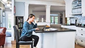 Businessperson checking invoices in the comfort of her own home