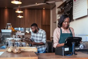 Young South African entrepreneurs working behind the counter of their cafe