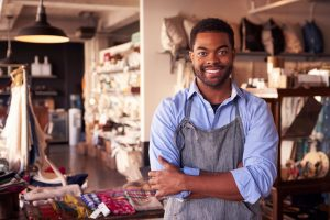South African small business owner working in his shop.